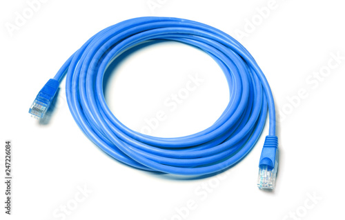 Cuadros en Lienzo Isolated blue patch cord internet cable on white background