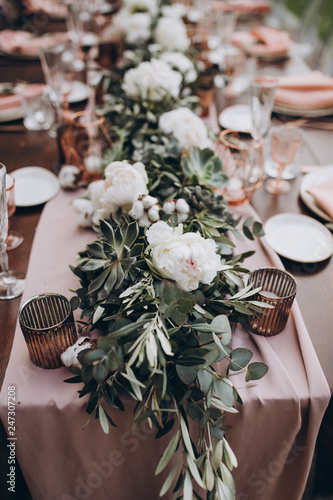 in the backyard of the villa in Tuscany there is banquet wooden table decorated Fototapete