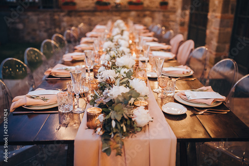 in backyard of villa in Tuscany there is banquet wooden table decorated with cot Fototapet