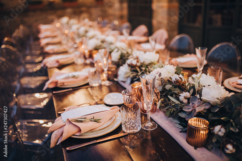 Tableau sur Toile in backyard of villa in Tuscany there is banquet wooden table decorated with cot