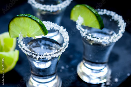 Set for tequila party with lime and salt on black background Fototapeta