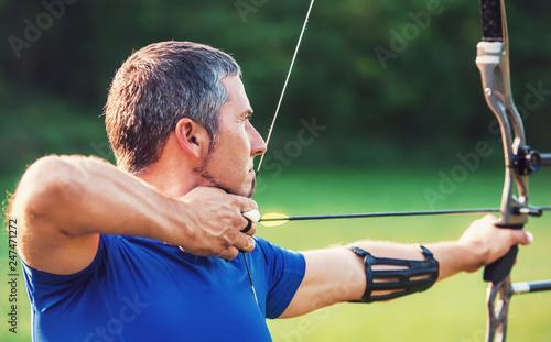 Obraz na plátně Archer. Sportsman practicing archery. Sport, recreation concept