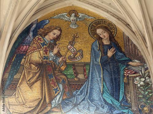 Fotografie, Obraz Mosaic of Annunciation from main portal of Maria am Gestade church in Vienna