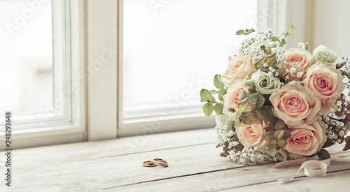 Fotografie, Obraz Pair of wedding rings and bridal bouquet