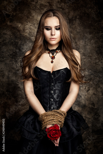 Tablou Canvas Gothic Woman Black Dress, Flower Rose in Hands Tied By Rope, Fashion Model Beaut