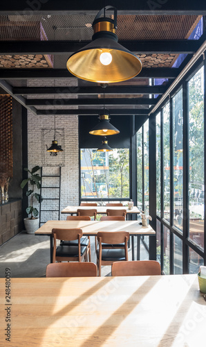 Fotografia Table and chair set in modern cafe minimalistic interior design with big window