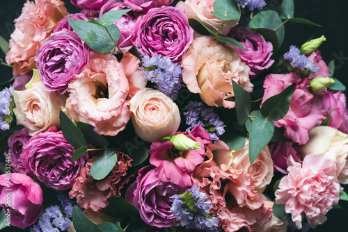 Obraz na plátne Beautiful pink and purple Peonies and roses bouquet with eucalyptus