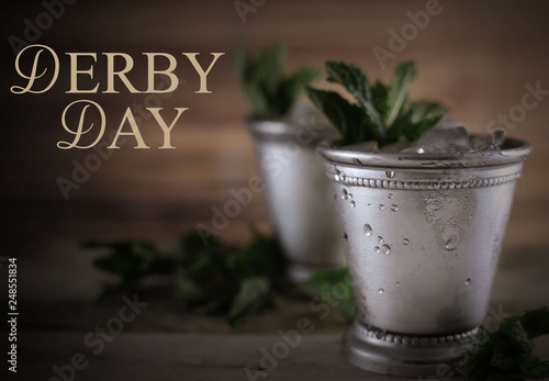 Foto Image for Kentucky Derby in May showing two silver mint julep cups with crushed