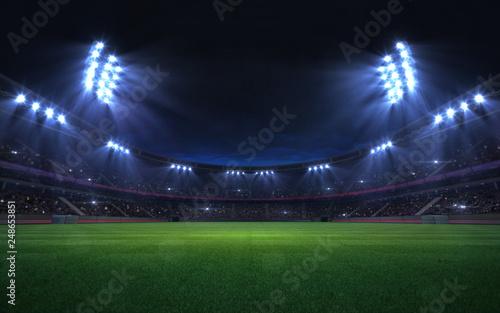 Obraz na plátne universal grass stadium illuminated by spotlights and empty green grass playgrou