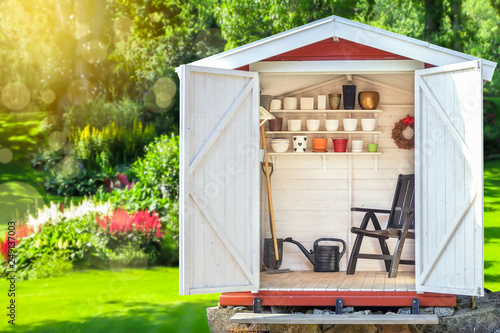 Fotomural Garden shed filled with gardening tools