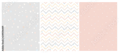 Set of 3 Bright Delicate Chevron, Hearts and Dots Vector Patterns. Irregular Tiny Dots Pattern. Hand Drawn Chevron Designs. White, Gray, Beige and Pink Pastel Design. Cute Nursery Art Patterns.