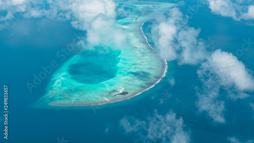 Fotografia Maldives from the Sky with the blue sea and white sand and beach in the indian o
