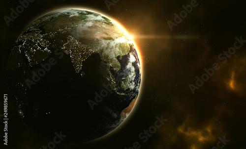 Obraz na plátně Planet Erde im Sonnenaufgang mit Galaxie