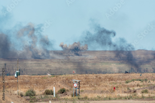 Giant outdoors explosion with fire and black smoke Fototapet