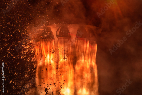 Fotografia, Obraz Rocket engines and fire duting the missile launch at night, close up conceptual image