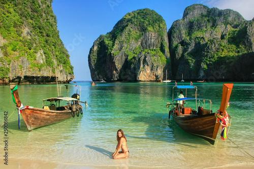 Young woman sitting on the beach at  Maya Bay on Phi Phi Leh Island, Krabi Provi фототапет