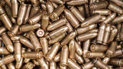 Slika na platnu Top view of gun ammunition. Bullets for pistol