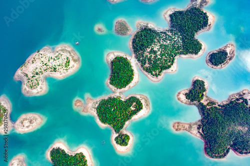 Fotografia, Obraz (View from above) Stunning aerial view of a heart-shaped island in the middle of a group of other islands in Nam Ngum Reservoir in Thalat located in northern Laos