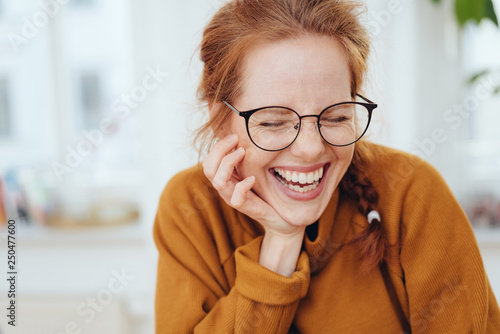 Fototapeta Pretty red-haired girl laughing portrait