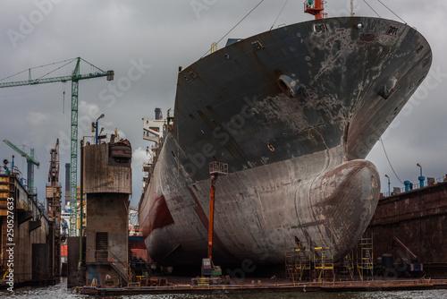 Fototapeta Gdansk shipyard with monumental bow of cargo ship.