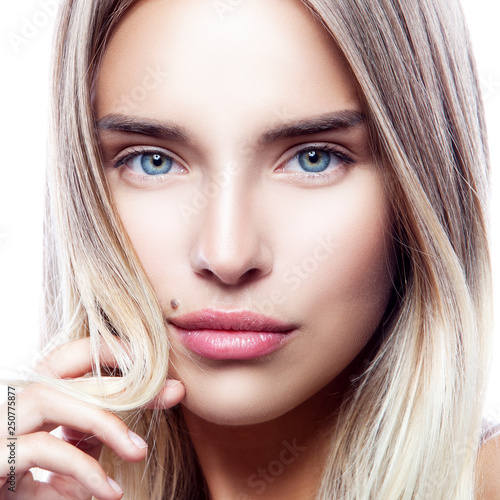 Leinwand Poster Close-up beauty face of young model girl with healthy clean fresh skin, natural make-up, blond hair, blue eyes