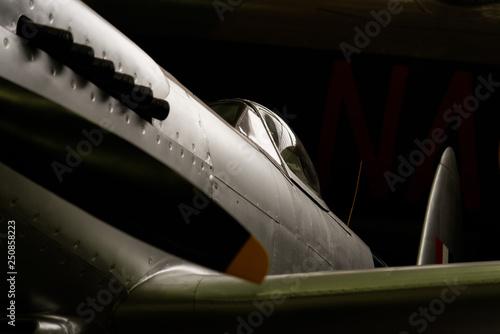Obraz na płótnie Cockpit and exhaust of a natural metal finish Supermarine Spitfire fighter plane