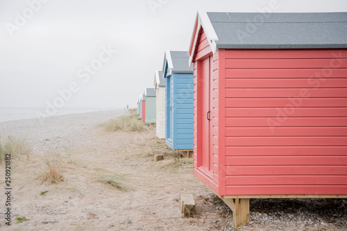 Findhorn, Scotland - July 2016: Colourful beach huts along the coast at Findhorn Fototapet