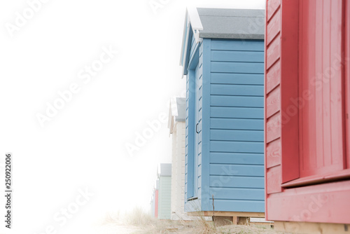 Fotografie, Tablou Findhorn, Scotland - July 2016: Colourful beach huts along the coast at Findhorn