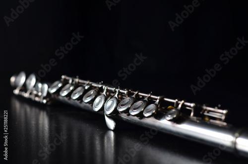 Fotografija Glossy silver transverse flute on a black background