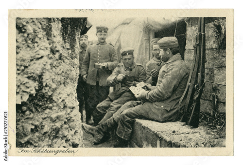 Photo German historical photo postcard:  Soldiers in the trench Smoking pipes, playing cards