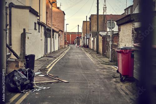 Vászonkép dirty alley in city