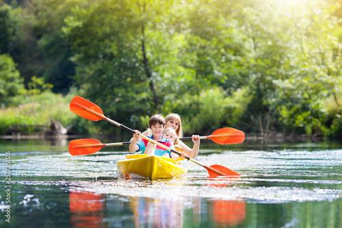 Tela Child on kayak. Kids on canoe. Summer camping.