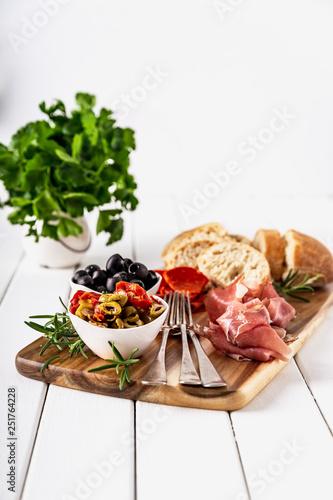Obraz na płótnie Italian antipasti with mediterranean olives, parma ham