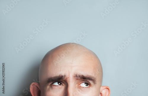 Fotografia, Obraz Emotional portrait of surprised bald man