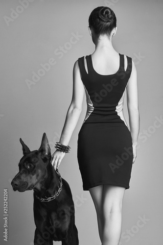 Girl with Doberman. Beautiful young woman with Dog Fototapete