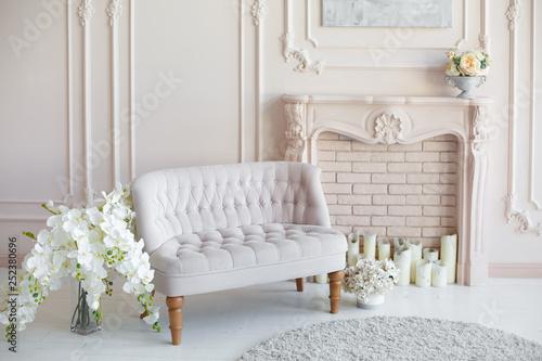 Canvas-taulu Elegant soft arm-chair near a fireplace