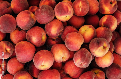 Canvas Print group of ripe peaches background