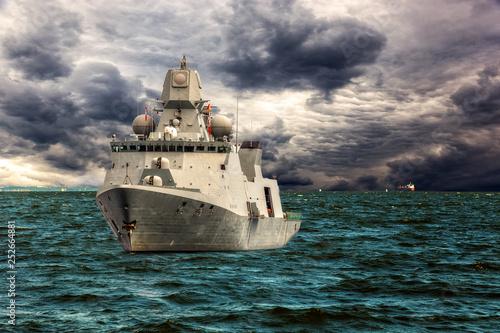 Canvas Print Warship on sea of dramatic scenery.
