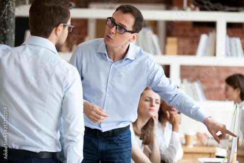 Stampa su Tela Angry businessmen colleagues quarrelling in shared office