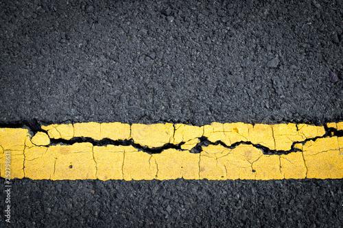 asphalt crack background. Fototapeta