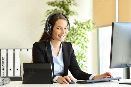 Slika na platnu Happy tele marketer working looking at camera at office