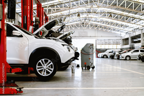 Fotografie, Tablou closeup car in repair station and body shop with soft-focus and over light in th