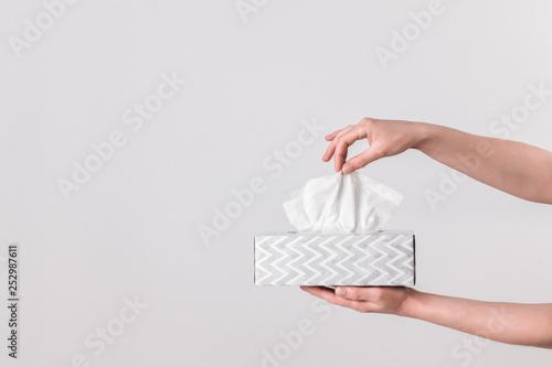 Murais de parede Delicate female hands holding a tissue box