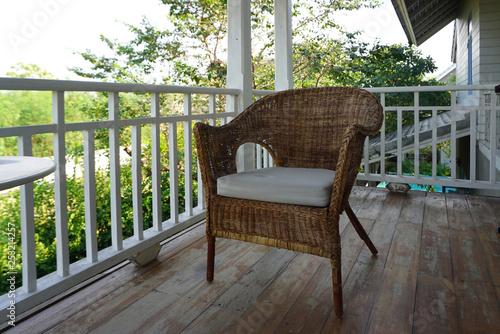 Canvas vintage rattan chair on terrace deck outdoor