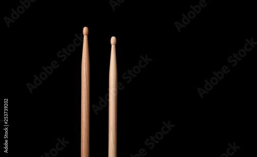 Photo drum stick on black background