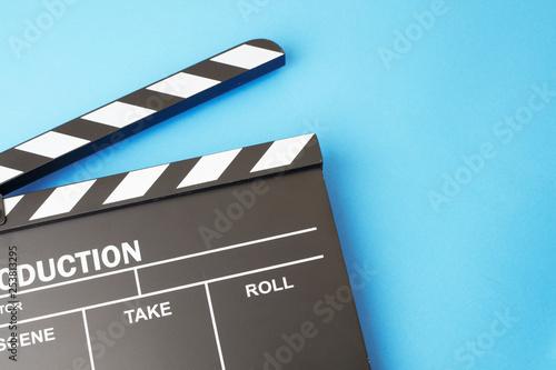 Valokuvatapetti Movie clapper-board on blue background