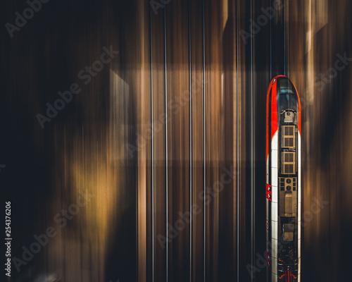 Fotografie, Obraz Fast train - panning by drone