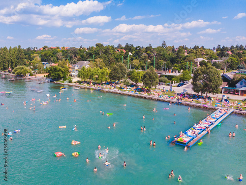 Fotografie, Obraz aerial view of lake with swimming people. summer time