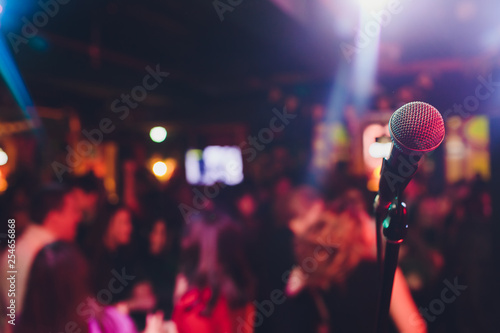 microphone against blur on beverage in pub and restaurant background.