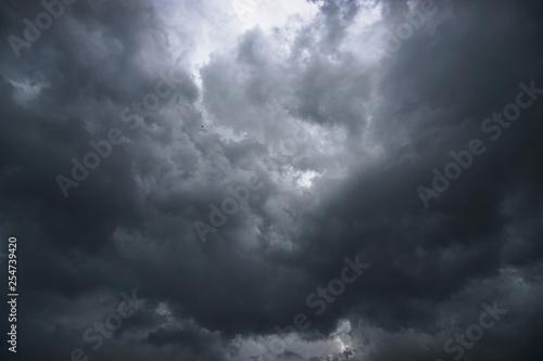 Fotografie, Obraz Dark, grim, stormy, rainy sky with rays of light